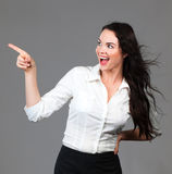 Beautiful business woman pointing at copyspace. Beautiful young smiling business woman pointing to copyspace Royalty Free Stock Photo