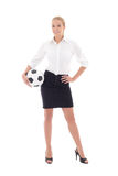 Beautiful business woman posing with soccer ball isolated on whi Stock Photography