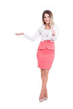 Beautiful business woman presenting with hand and showing OK. Royalty Free Stock Photography