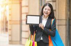 Beautiful business woman presenting her digital tablet Stock Images