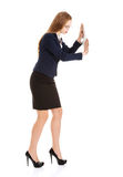Beautiful business woman pushing copy space. Royalty Free Stock Images