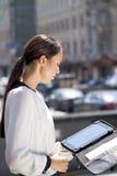 Beautiful business woman reading notepad Stock Photos