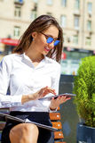Beautiful business woman reading notepad Stock Photo