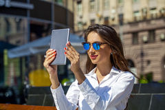 Beautiful business woman reading notepad Stock Image