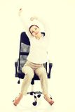 Beautiful business woman relaxing on a chair. Royalty Free Stock Image