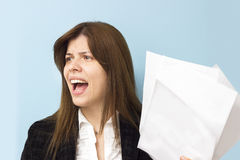 Beautiful business woman screaming and stressing over work Royalty Free Stock Photos