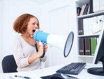 Beautiful business woman shouting into microphone Stock Image