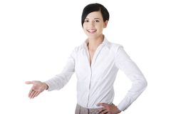 Beautiful business woman showing copy space Stock Photos