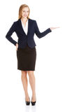Beautiful business woman showing copy space on palms. Royalty Free Stock Photography