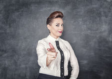 Beautiful business woman showing gun sign Royalty Free Stock Image