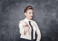 Beautiful business woman showing gun sign Royalty Free Stock Image