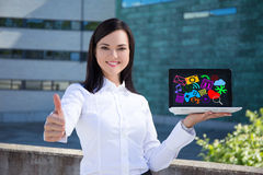 Beautiful business woman showing laptop with colorful media icon. Young beautiful business woman showing laptop with colorful media icons and applications and Royalty Free Stock Image