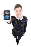 Beautiful business woman showing mobile phone with real estate a Stock Photos