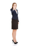 Beautiful business woman showing stop gesture by hand. Stock Image