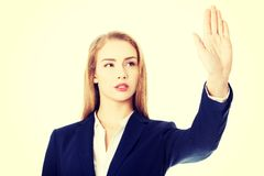 Beautiful business woman showing stop gesture. Royalty Free Stock Photos