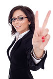 Beautiful business woman showing victory sign Stock Photo