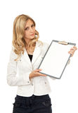 Beautiful business woman shows a tablet Royalty Free Stock Photography