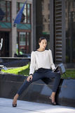 Beautiful business woman sitting on a bench Royalty Free Stock Image