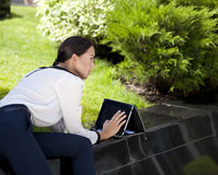 Beautiful business woman sitting on a bench Royalty Free Stock Photo