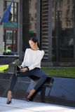 Beautiful business woman sitting on a bench Stock Image