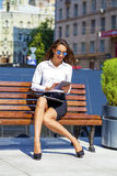 Beautiful business woman sitting on a bench Royalty Free Stock Photos