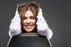Beautiful business woman sitting in chair Stock Photo