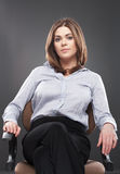 Beautiful business woman sitting in chair Stock Photos