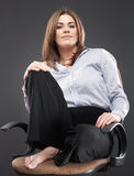 Beautiful business woman sitting in chair Royalty Free Stock Photography