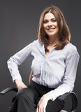 Beautiful business woman sitting in chair Royalty Free Stock Photo