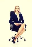 Beautiful business woman is sitting on a chair Royalty Free Stock Images