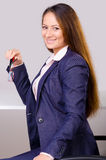 Beautiful business woman sitting at her desk Stock Photography