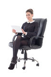Beautiful business woman sitting on office chair with tablet pc. Isolated on white background Stock Photography