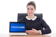 Beautiful business woman sitting in office and showing laptop wi Stock Photo
