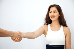 Beautiful business woman in smart casual dress shaking hands wit Royalty Free Stock Images