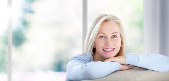 Free Beautiful Business Woman Smiling Friendly And Looking In Camera Near The Window In Office. Happy Woman`s Face Closeup Stock Images - 175085384