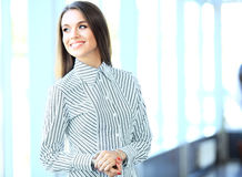 Beautiful business woman smiling and looking at camera Royalty Free Stock Photography