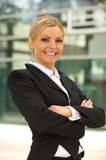 Beautiful business woman smiling outdoors Stock Images