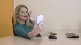 Beautiful business woman smiling and posing for selfie photo on mobile phone stock footage