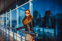 The woman at the airport with a bag Royalty Free Stock Images