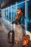 The woman at the airport with a bag Royalty Free Stock Photography