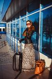 The woman at the airport with a bag Stock Photos