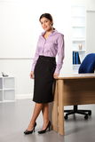 Beautiful business woman standing next to office d Royalty Free Stock Photo
