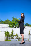 Beautiful business woman standing over urban background Royalty Free Stock Images