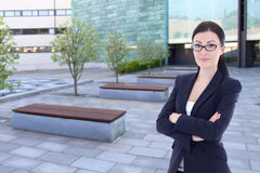Beautiful business woman standing on street against office build Royalty Free Stock Image