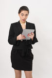 Beautiful business woman stares into a tablet Royalty Free Stock Photo