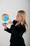 Beautiful business woman in suit holding a globe Stock Images