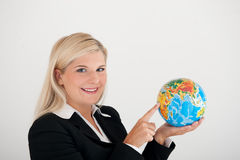 Beautiful business woman in suit holding a globe Stock Photography