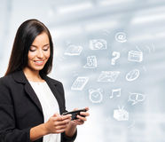 A beautiful business woman with a tablet Royalty Free Stock Photo