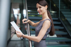 Beautiful business woman taking notes Royalty Free Stock Photo