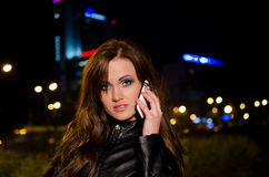 Beautiful business woman talking on a cell phone a Royalty Free Stock Photo